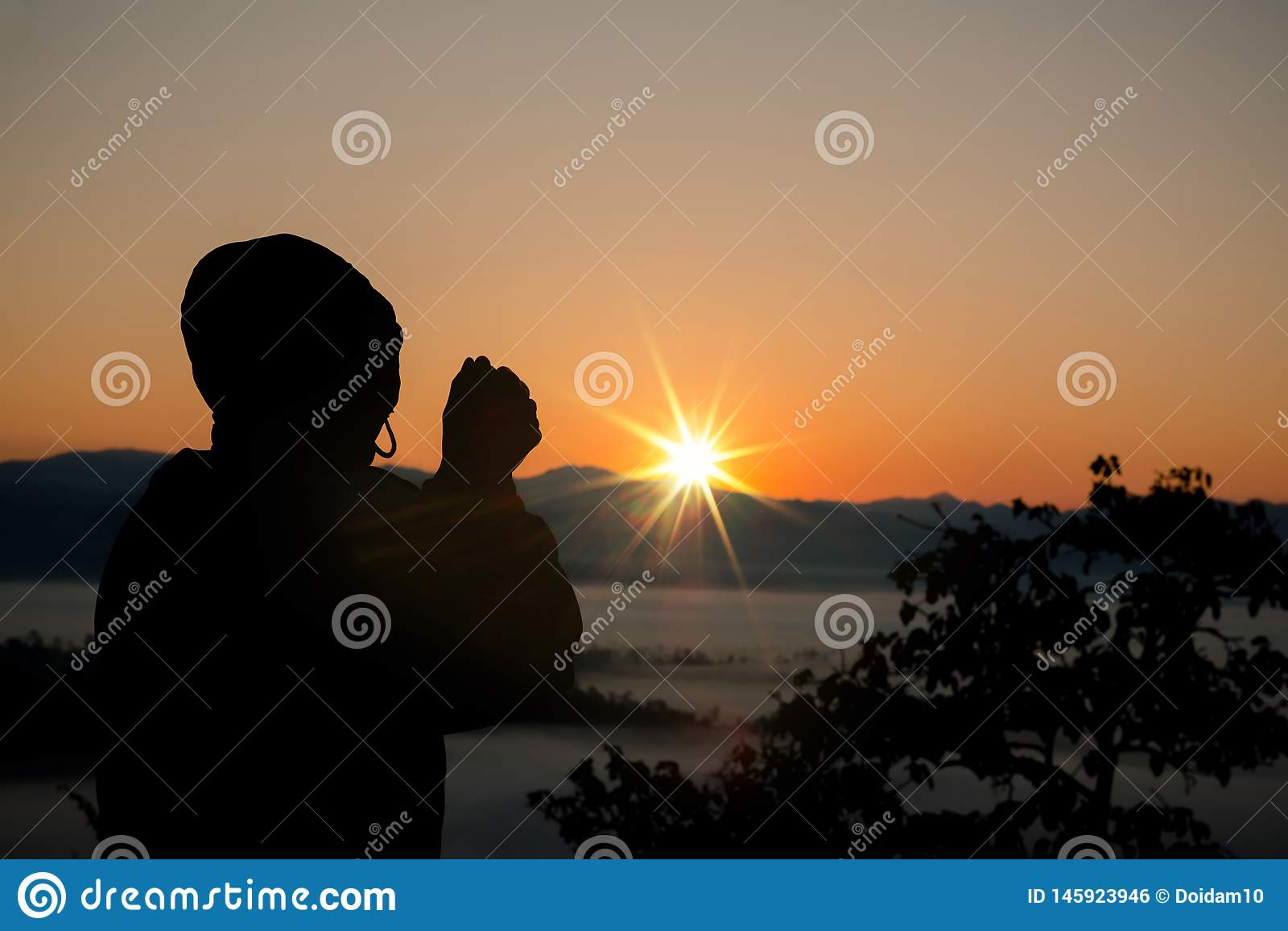 Silhouette of christian man hand praying,spirituality and religion,man praying to god.
