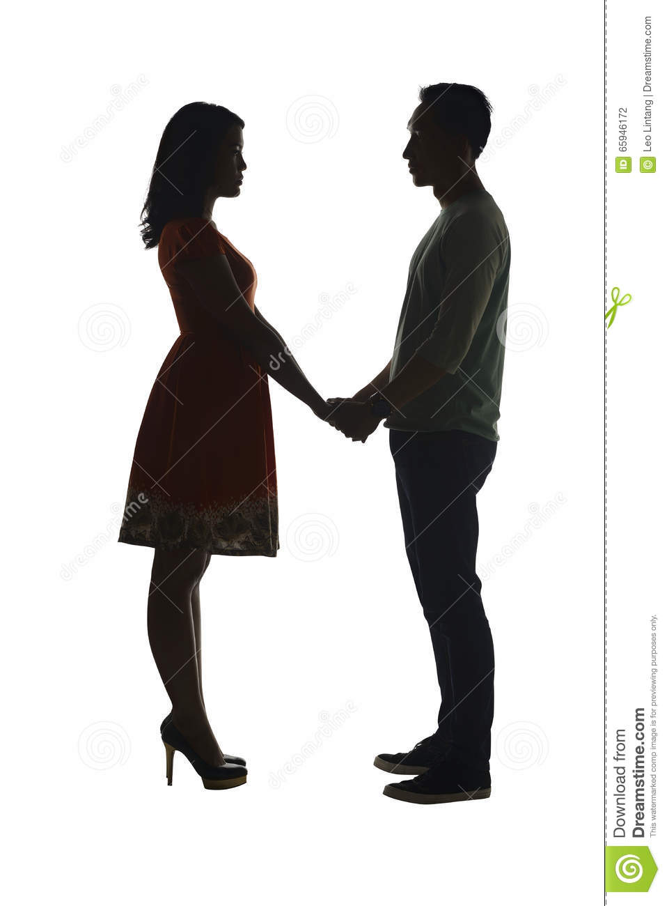 silhouette of couple holding hand