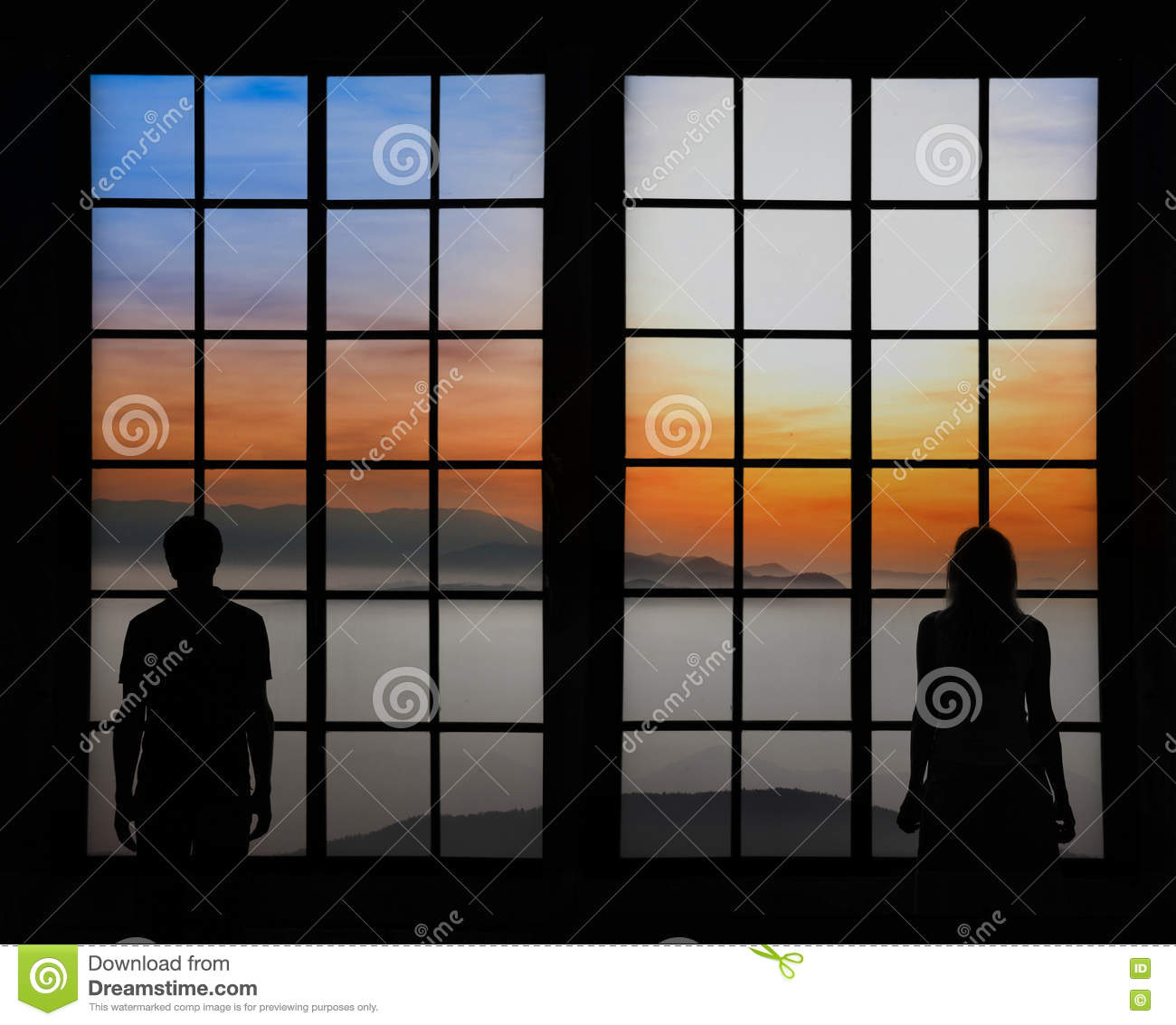 Silhouette of a couple looking through window