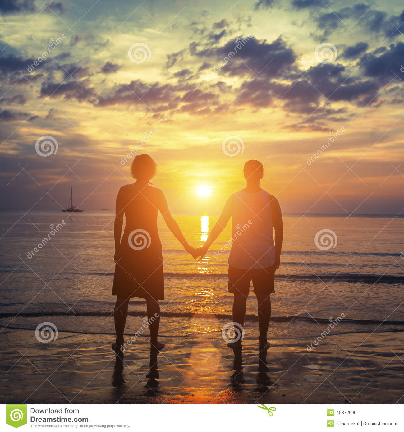 Silhouette Of A Couple On Their Honeymoon Standing On The
