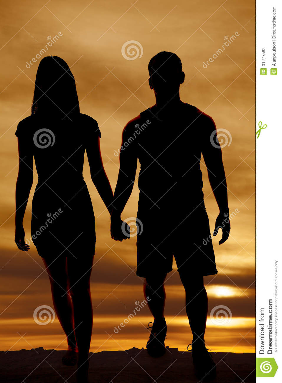 silhouette couple walking hold hands