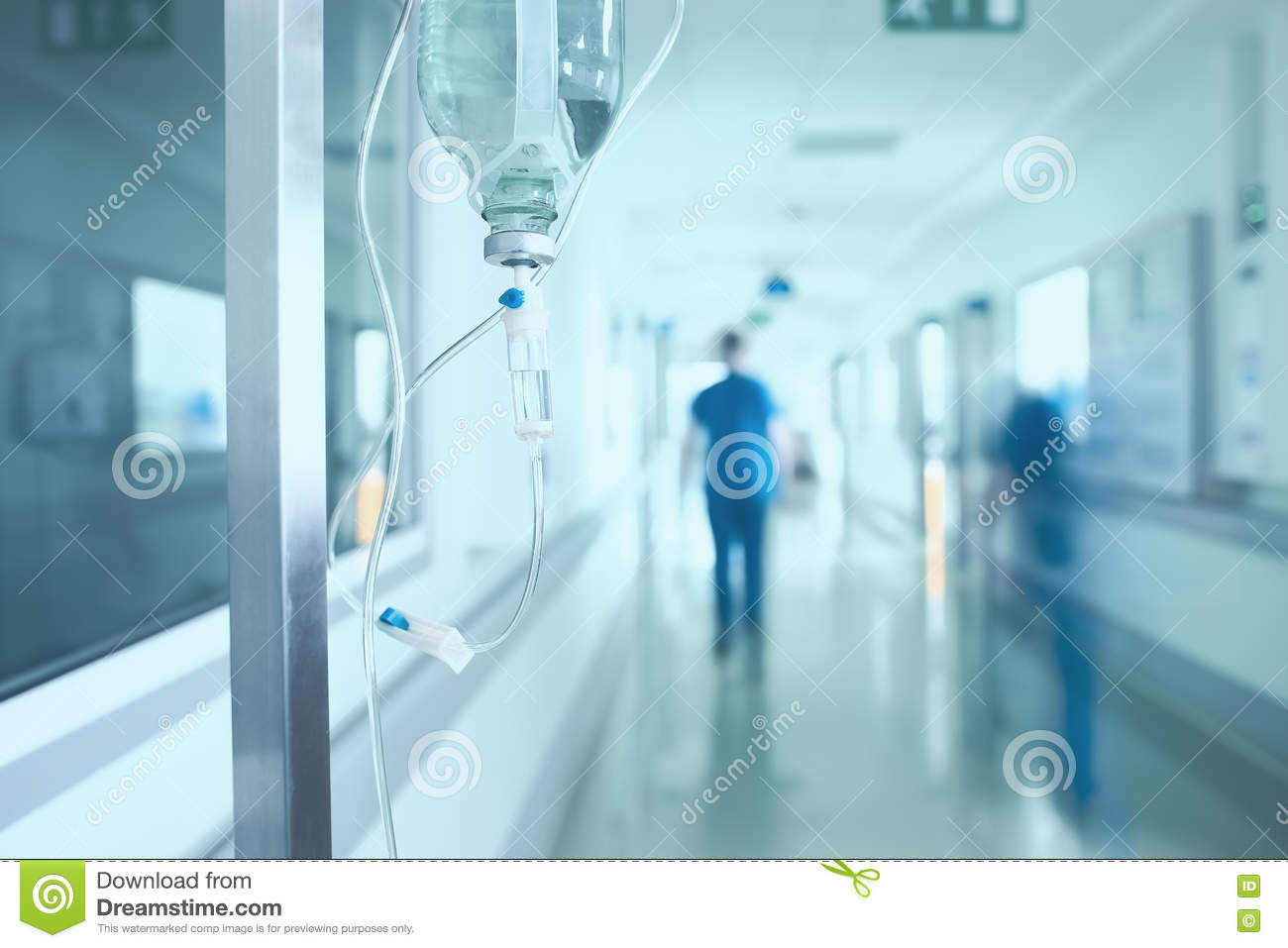 Silhouette of a doctor walking in a hurry in the hospital corridor