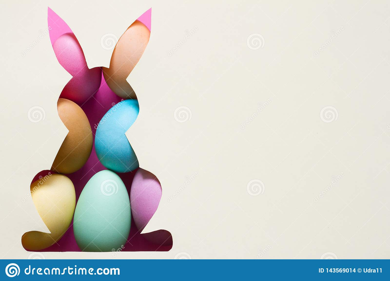 Silhouette of easter rabbit on paper with green grass and colorful egg abstract background