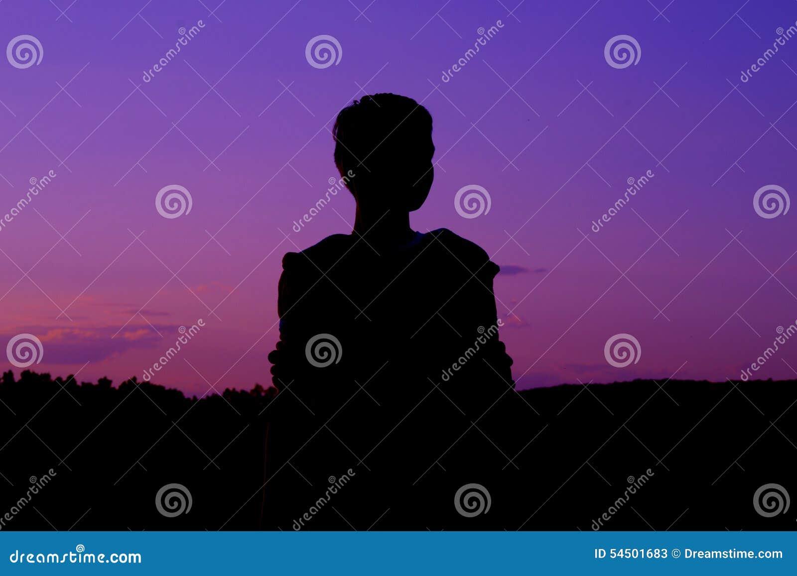 Silhouette en ciel pourpre