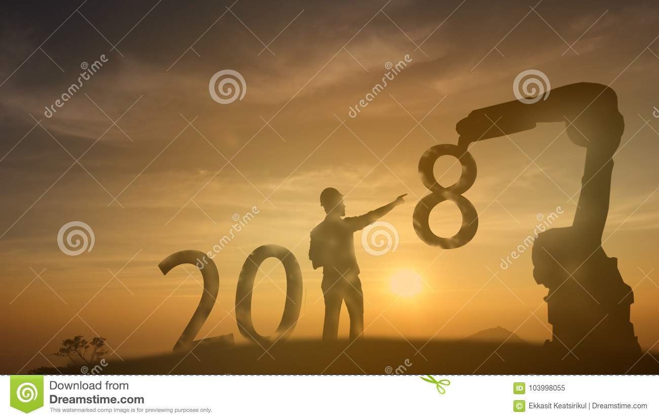 2018 silhouette engineering try to supervise the robot for complete 2018 new year with sunrise or sunset background
