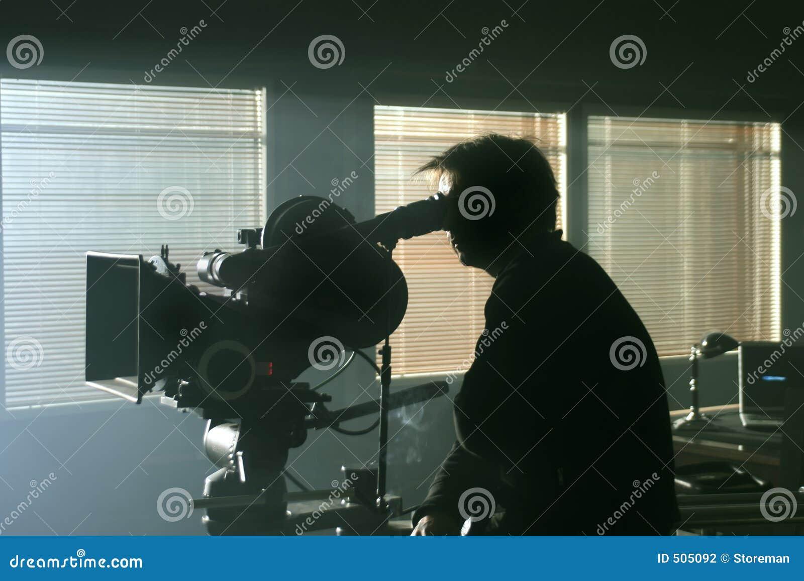 Silhouette för kameracameramanmörker