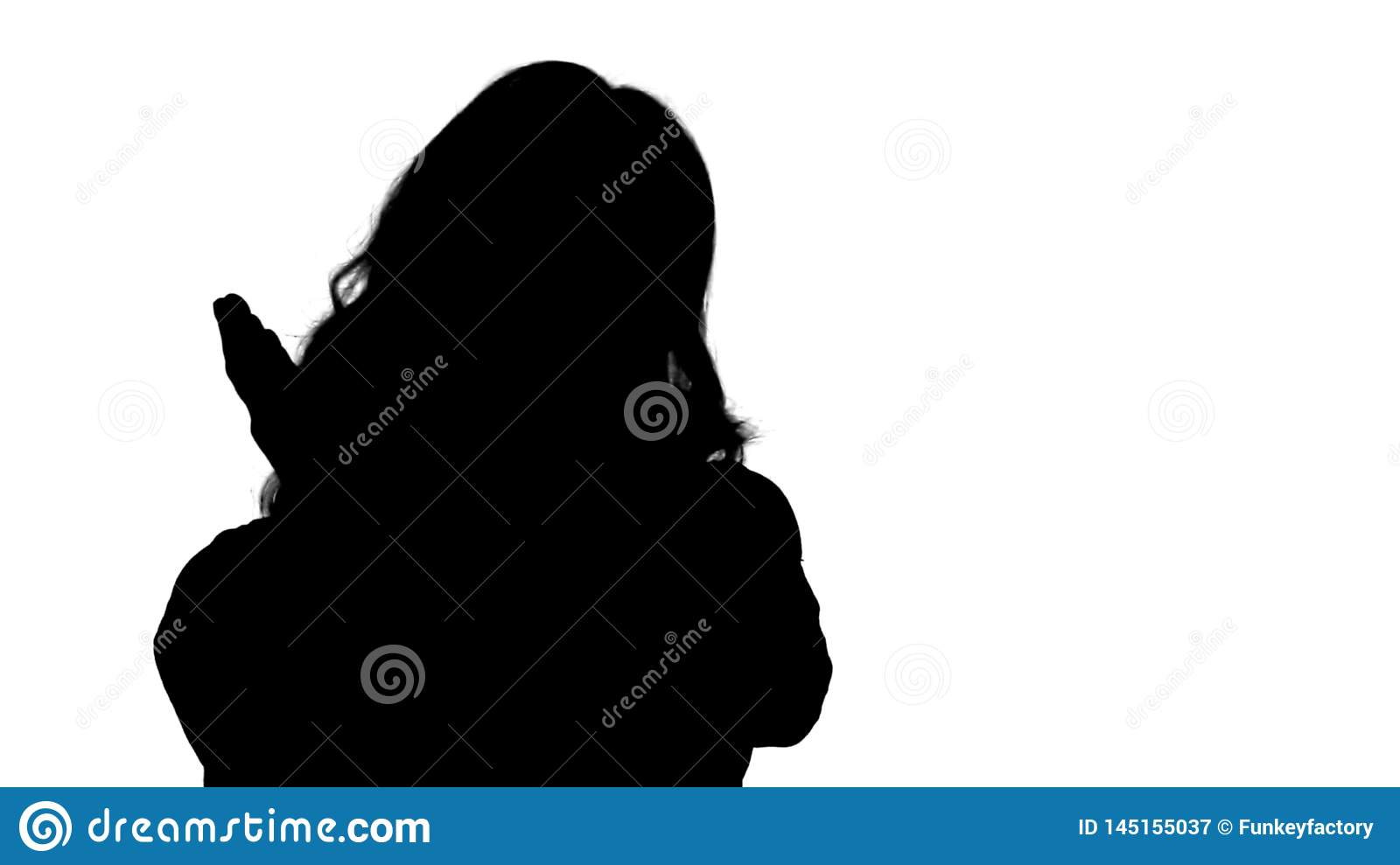 Silhouette Female blonde woman talking to camera being very happy.