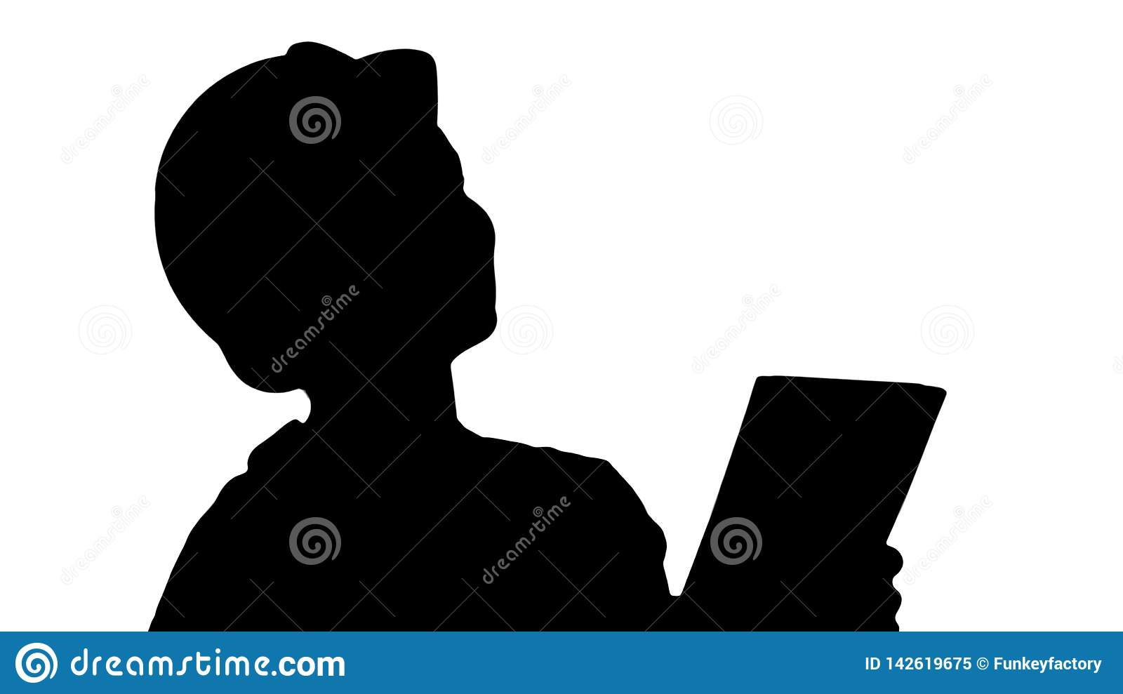 Silhouette Female construction engineer with a tablet computer at a construction site.