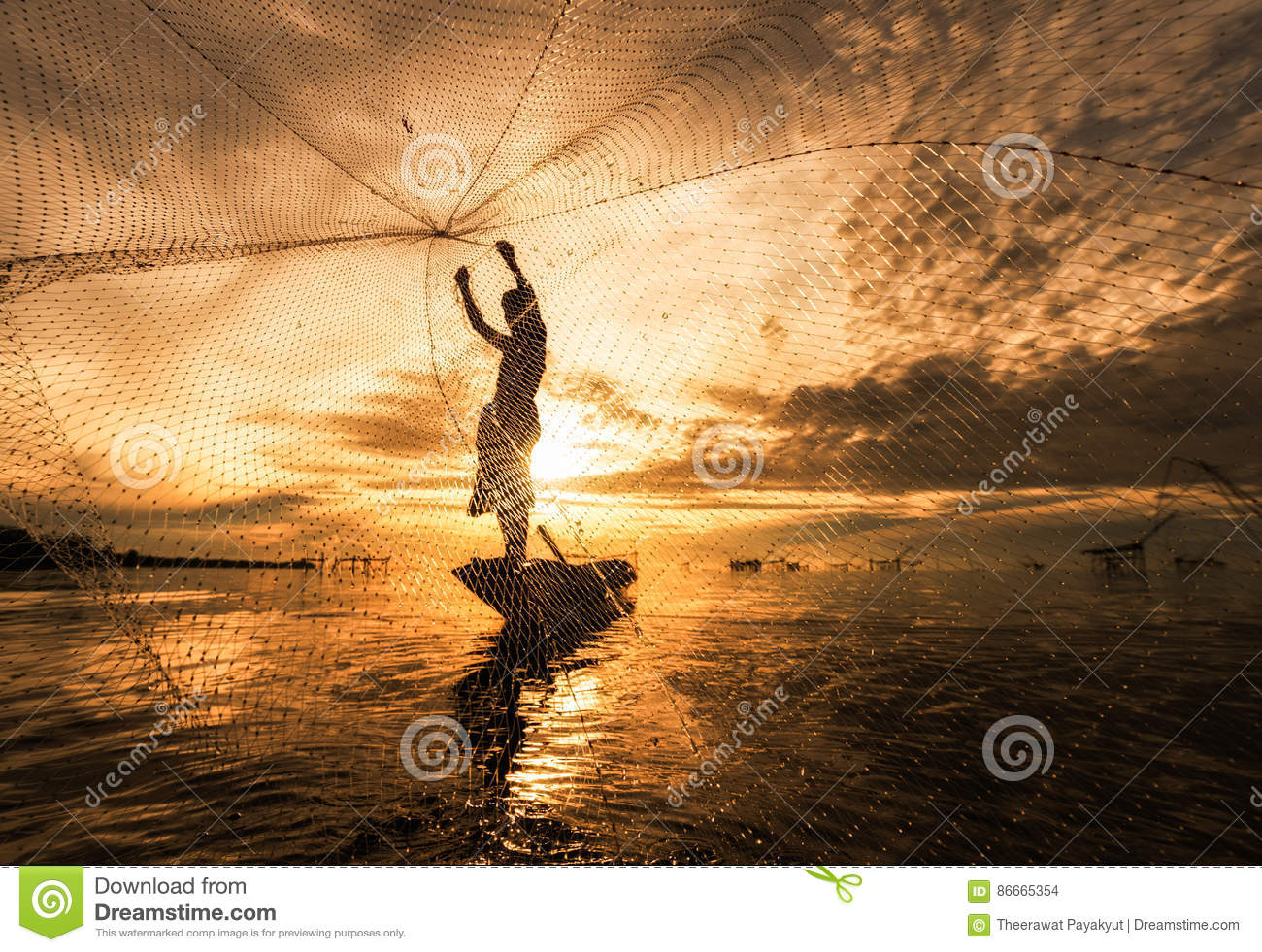 Silhouette Fisherman Fishing Nets on the boat.