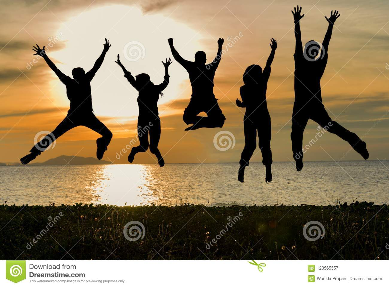 Silhouette of friends and teamwork jumping on beach during sunset time for success business.