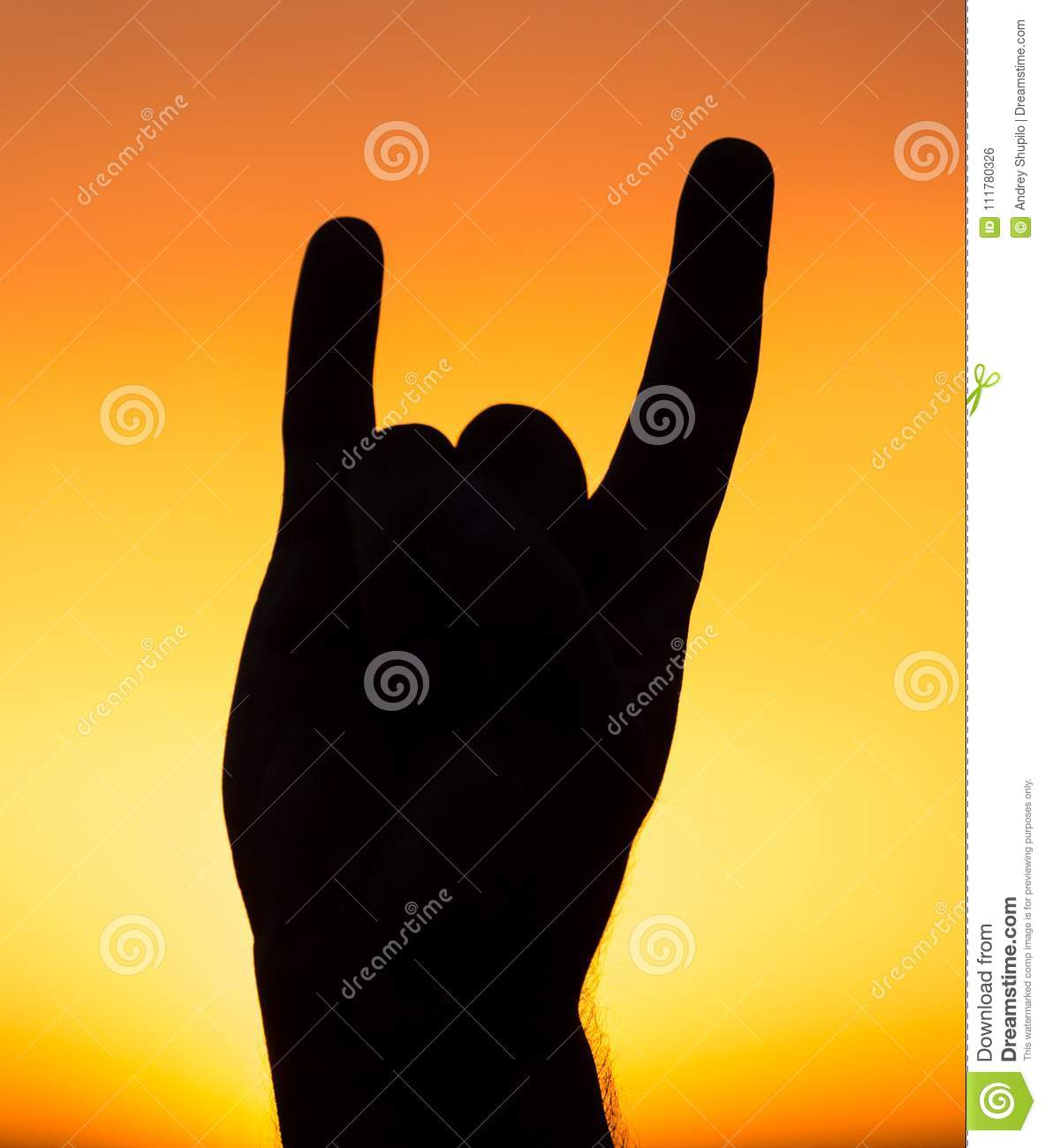 Silhouette of hand at sunset