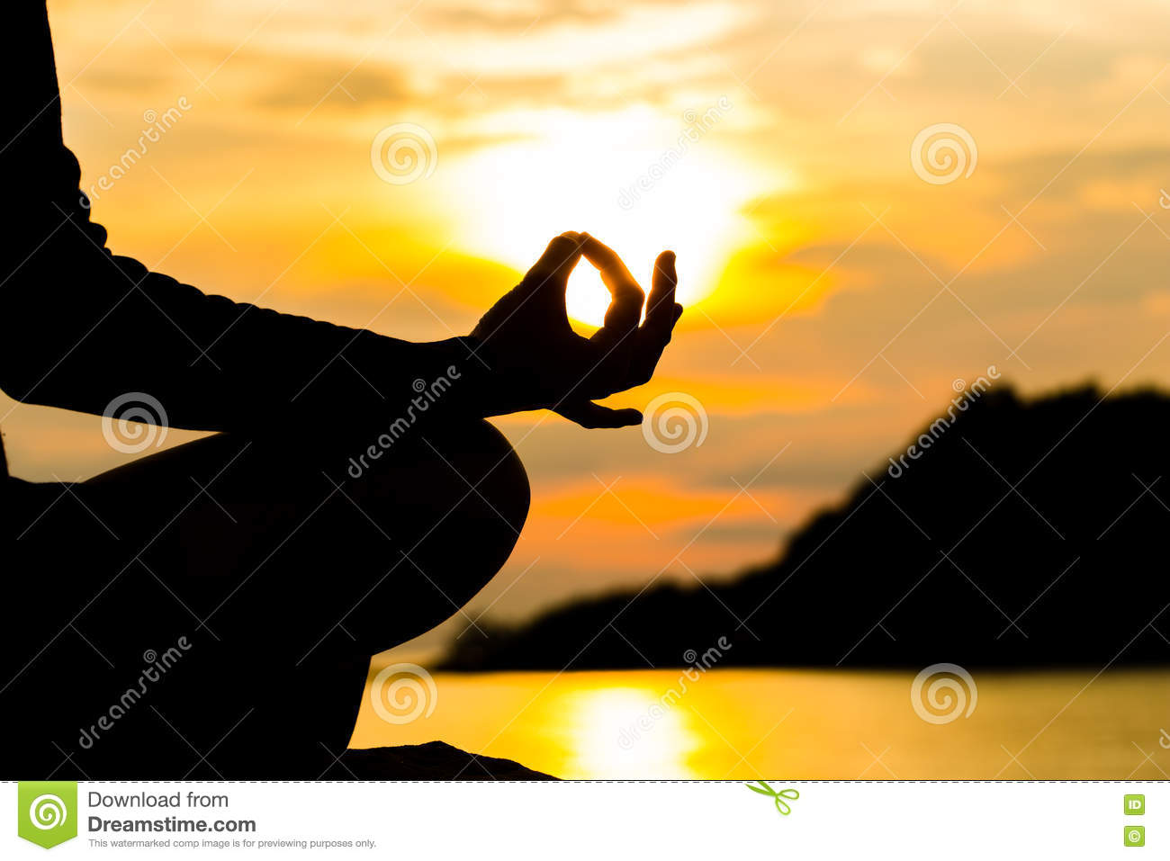 Download Silhouette Hand Of Woman Meditating In Yoga Pose Or Lotus Posit Stock Photo