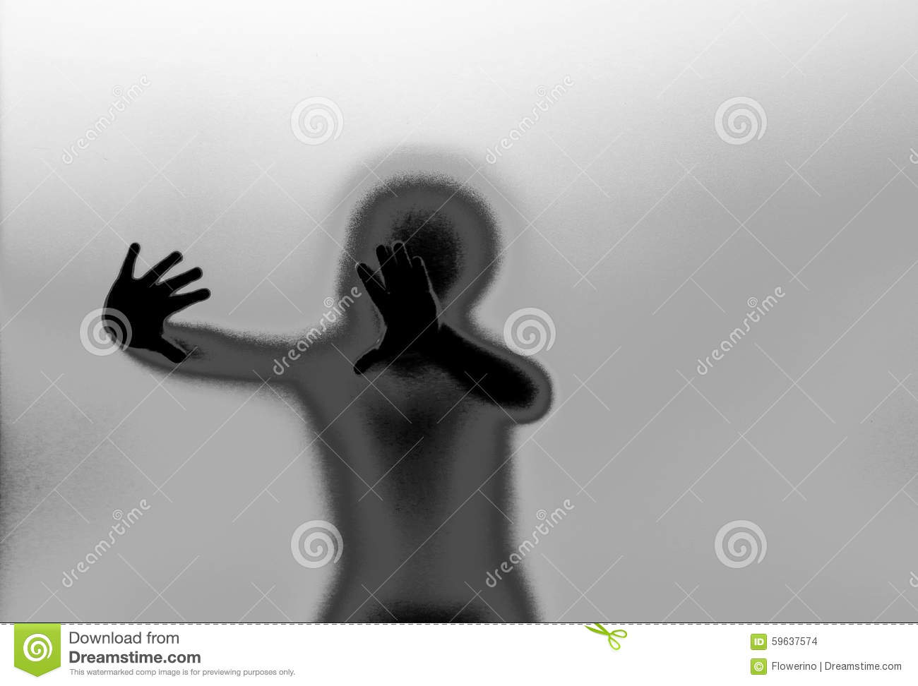 Silhouette and hands behind glass wall