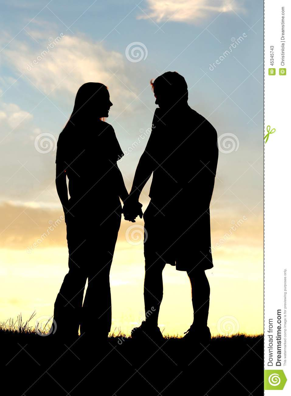 Silhouette Of Happy Couple Holding Hands And Talking At Sunset ... for Couple Holding Hands Silhouette Sunset  156eri