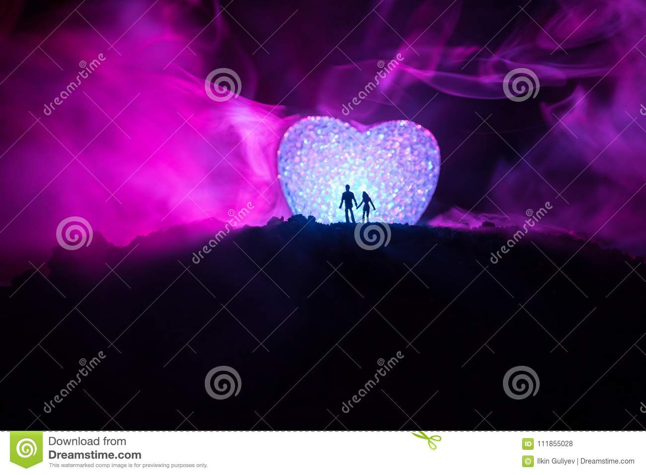 Silhouette of happy couple standing behind big shaped heart symbol royalty free stock photo buycottarizona Image collections