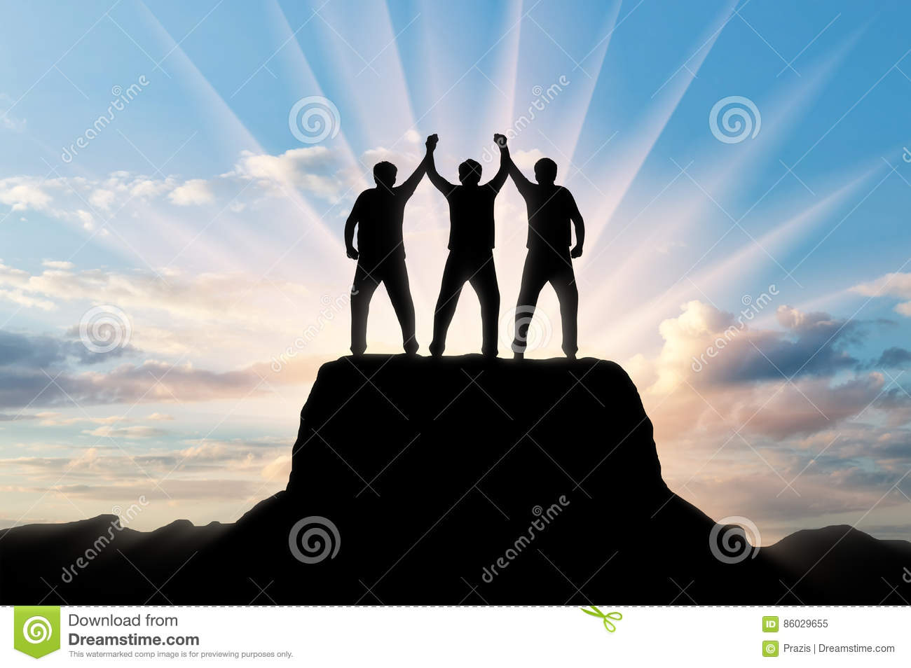 Silhouette of happy three climbers on the top