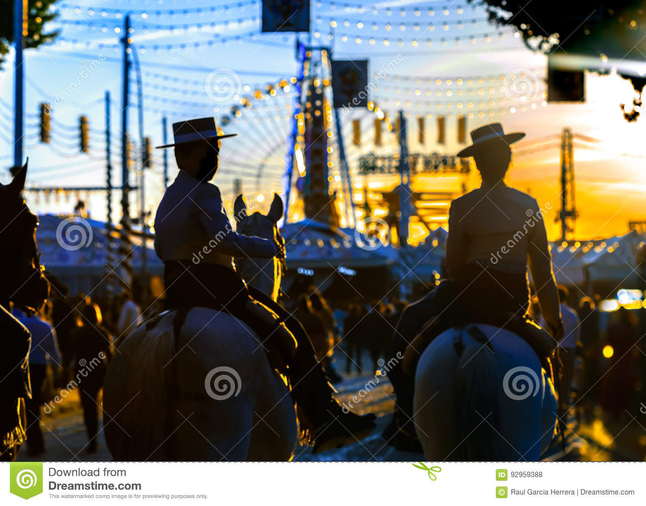 Silhouette of Horse riders at sunset. Seville`s April Fair. Spanish Culture.