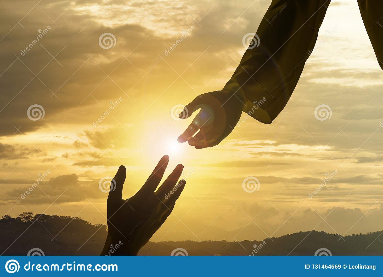 Silhouette of Jesus giving helping hand