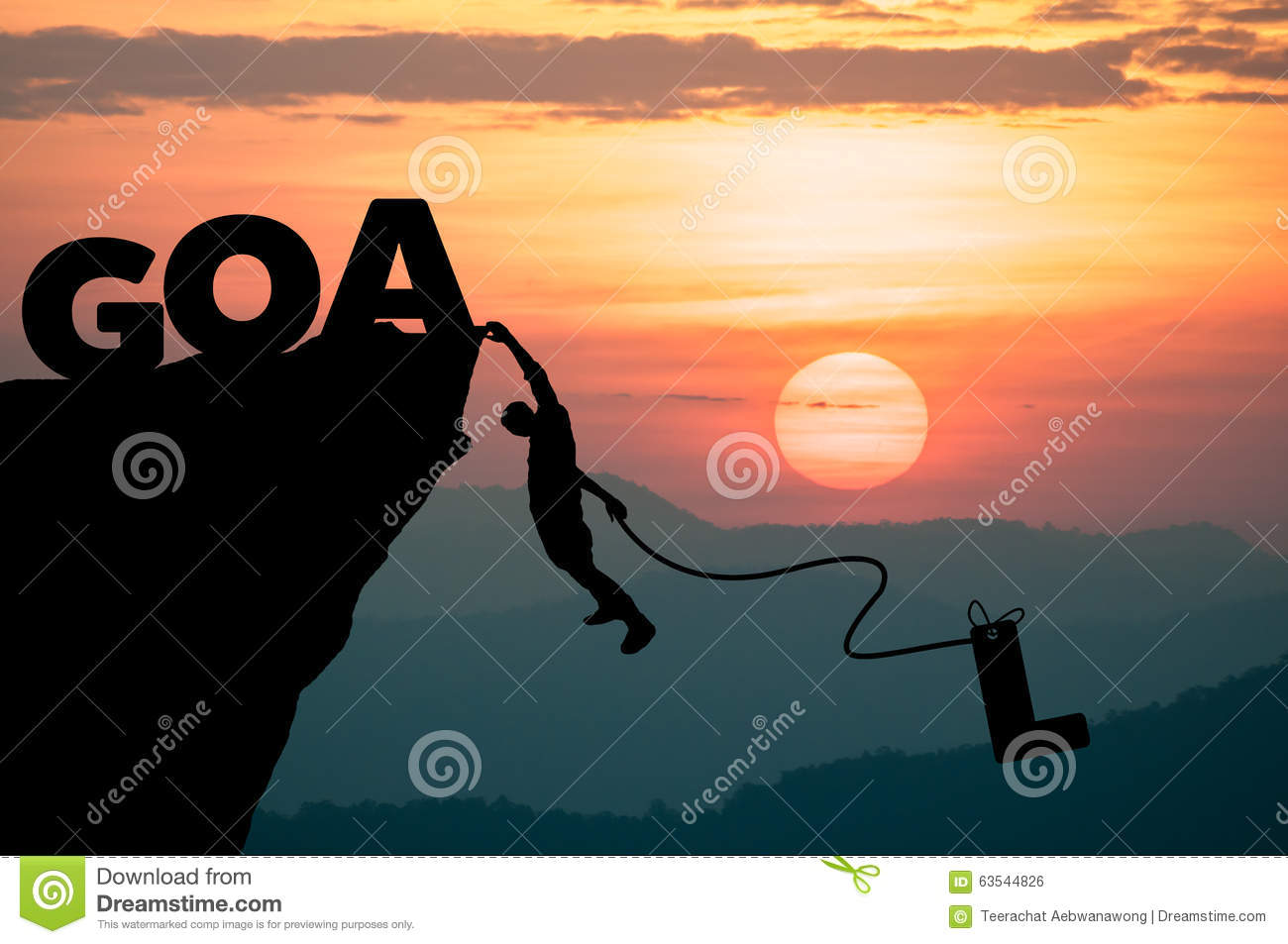 Silhouette Man climbs into cliff to make word GOAL (goal setting concept)