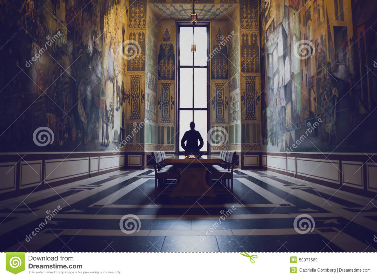 Silhouette of man in a grand hall