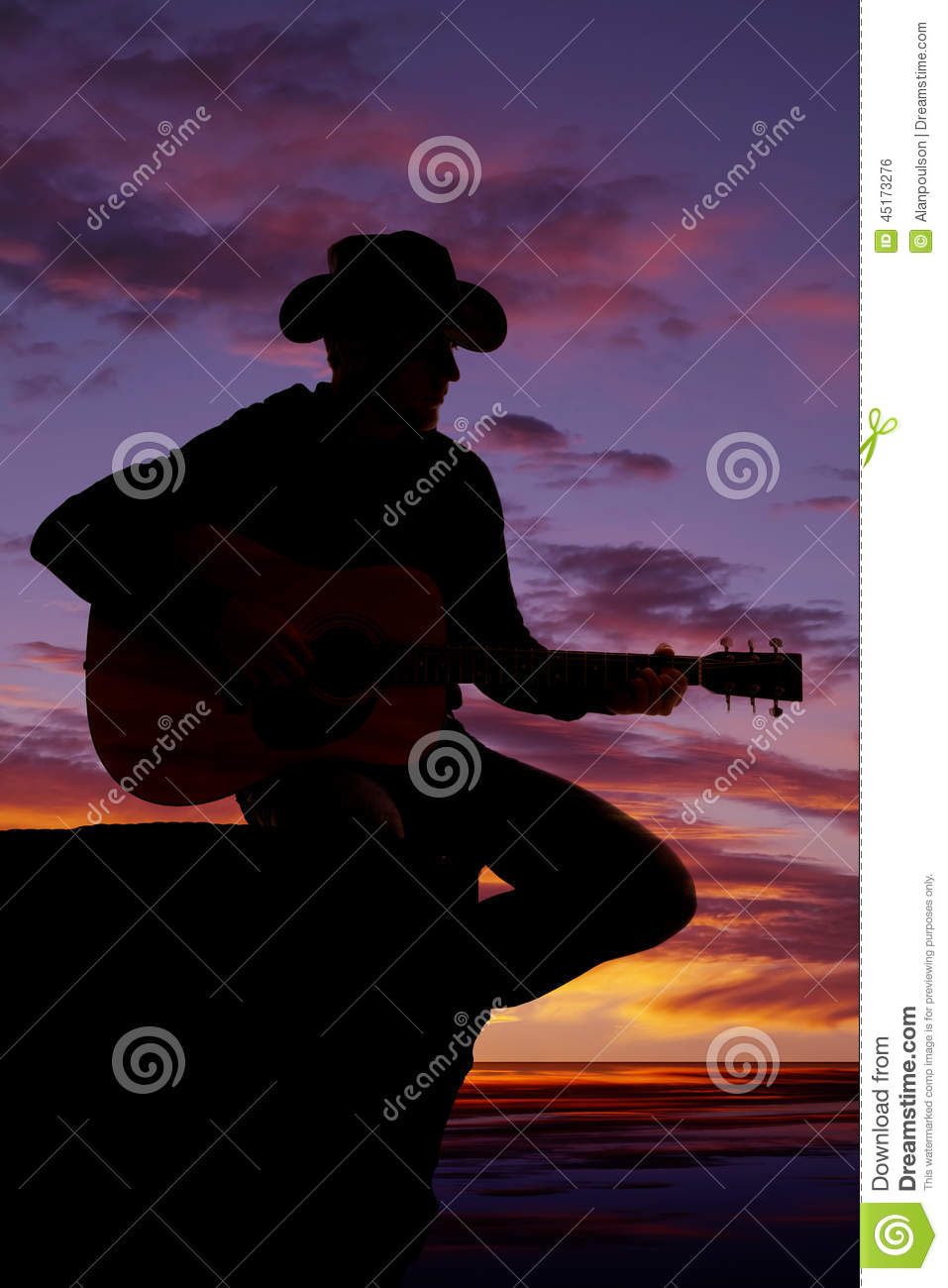 Silhouette Of Man With Guitar Sit By Water Sunset Stock ...