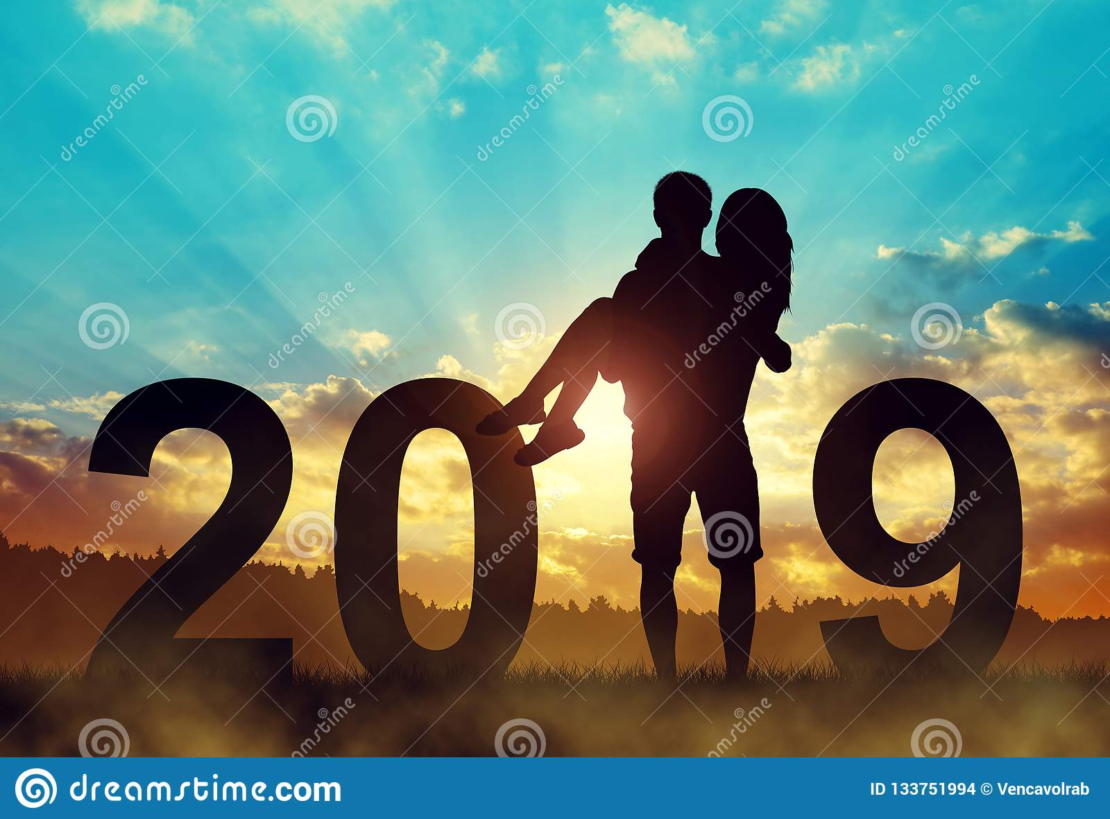 Silhouette of a man holding a woman in his arms.New Year 2019 concept.