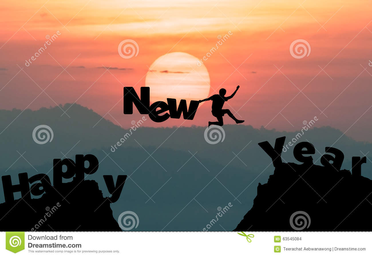 Silhouette man jumps to make the word Happy New Year