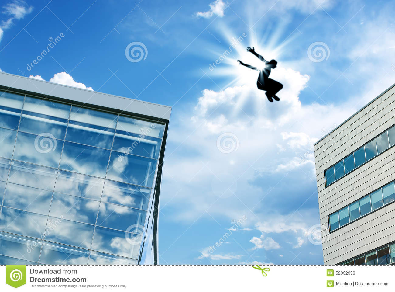 silhouette of a man leaping off building stock photo image of jump