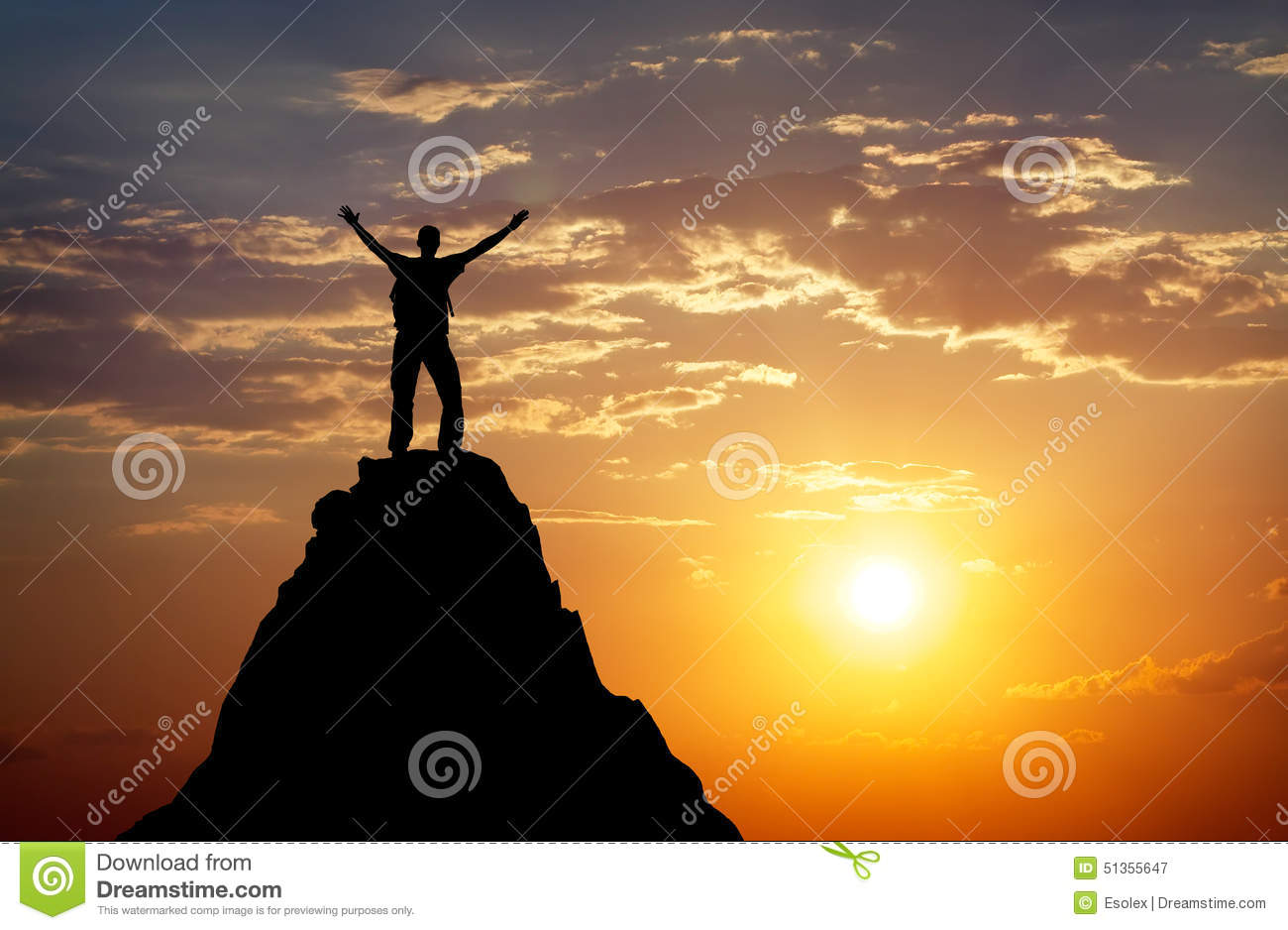 Silhouette of a man on a mountain top stock photo image for Living on a mountain