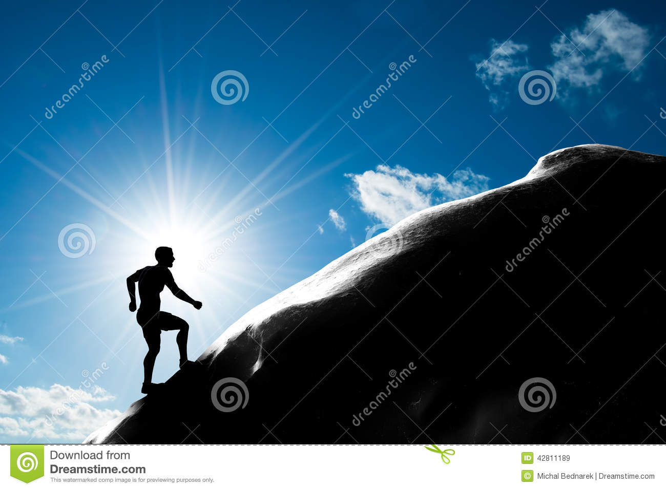 Silhouette of a man running up hill to the peak of the mountain