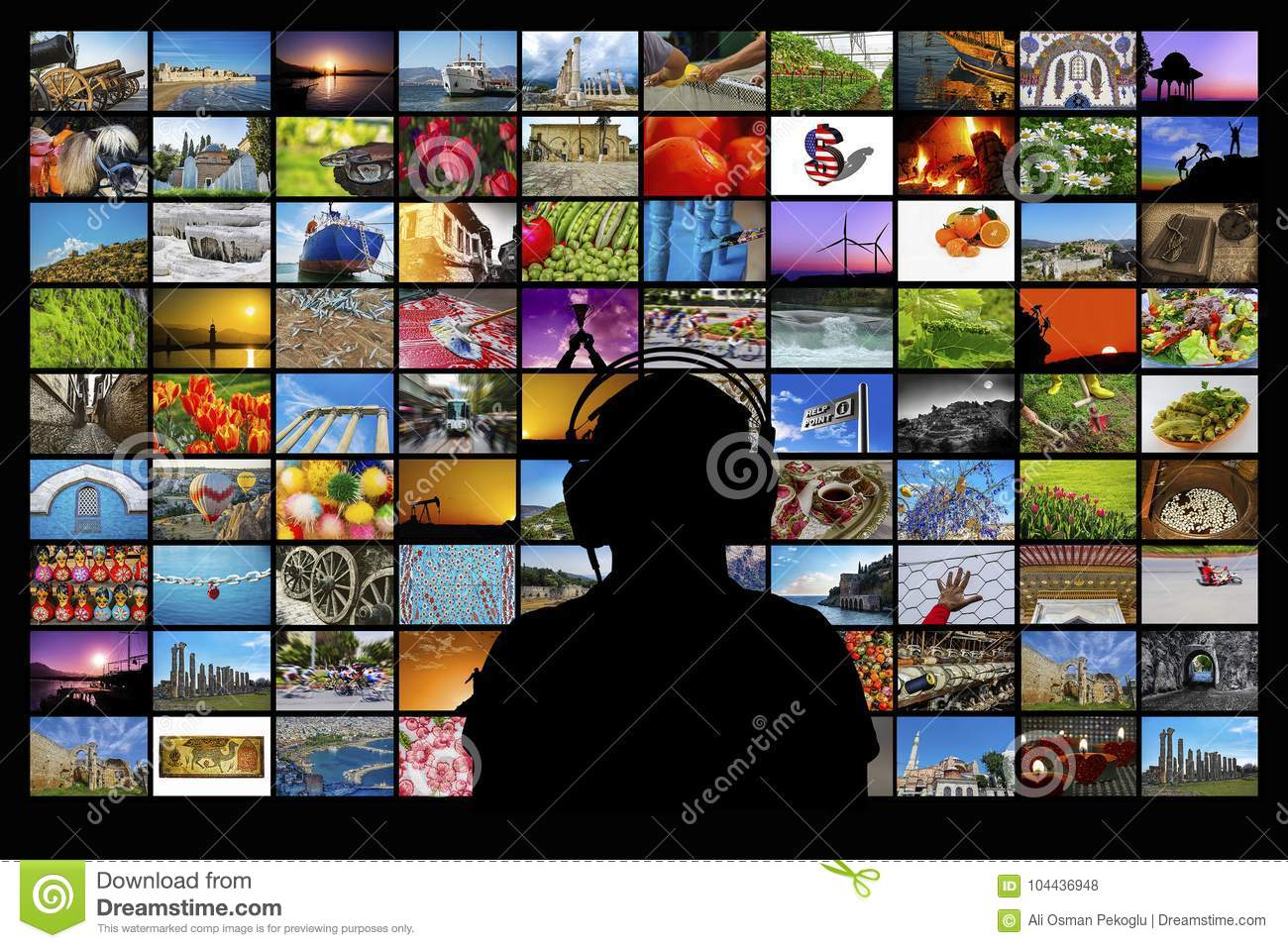 Silhouette Of Man Sitting In Front Of Video Wall Watching Multimedia