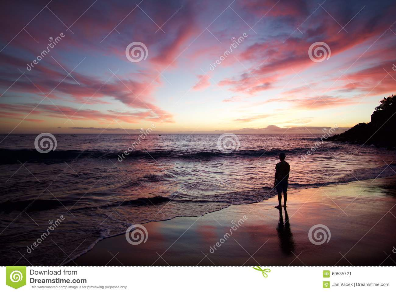 Silhouette of the man standing on the beach at sunset - Standing canarias ...