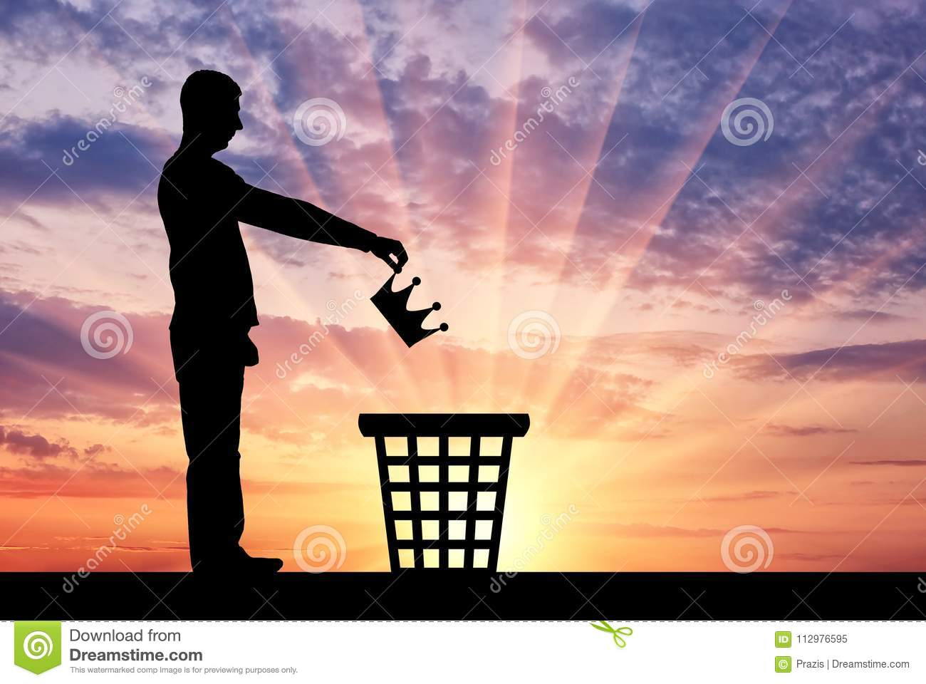 Silhouette of a man throws a crown in the garbage bin