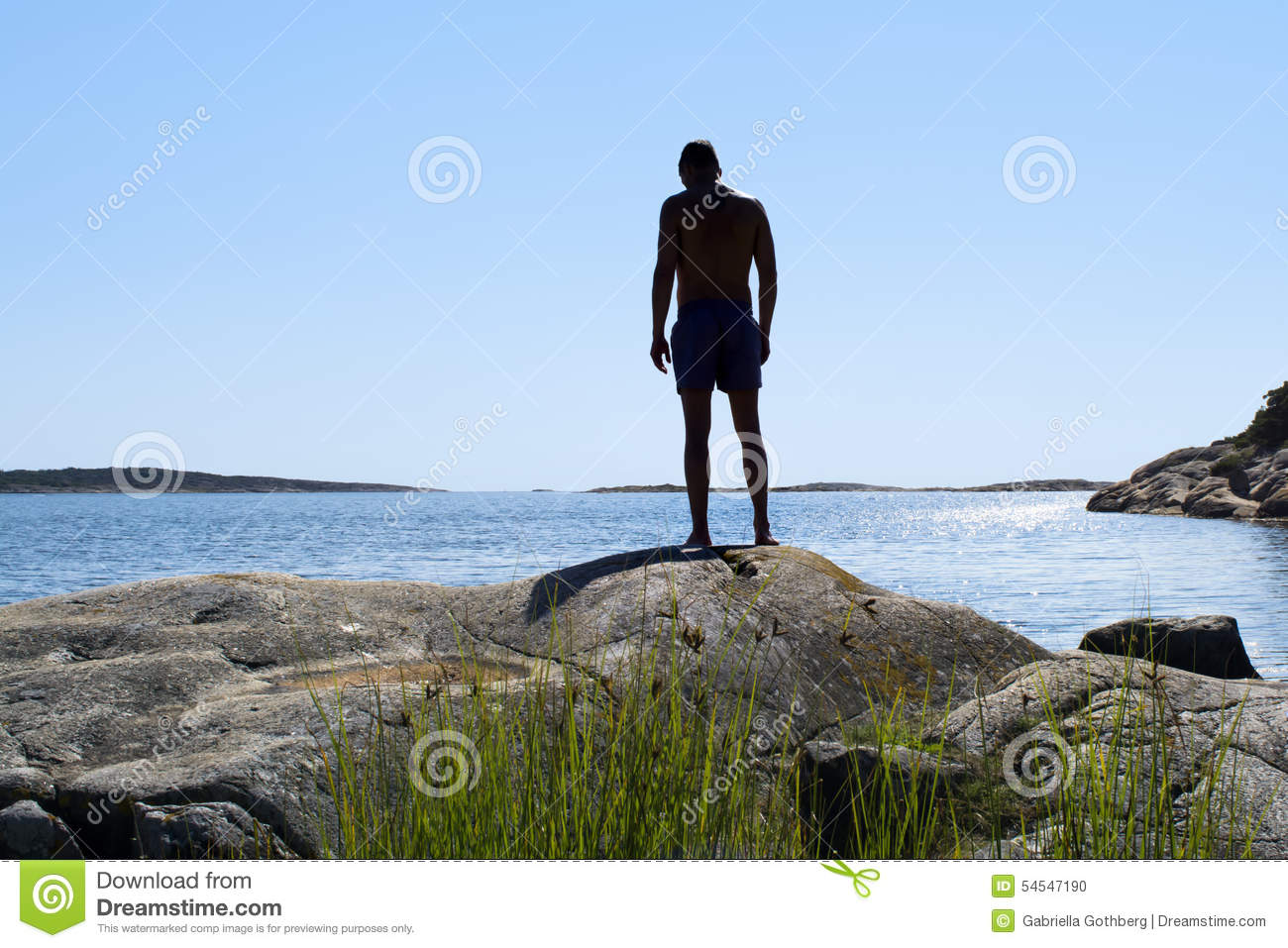 Silhouette of man about to dive into the ocean
