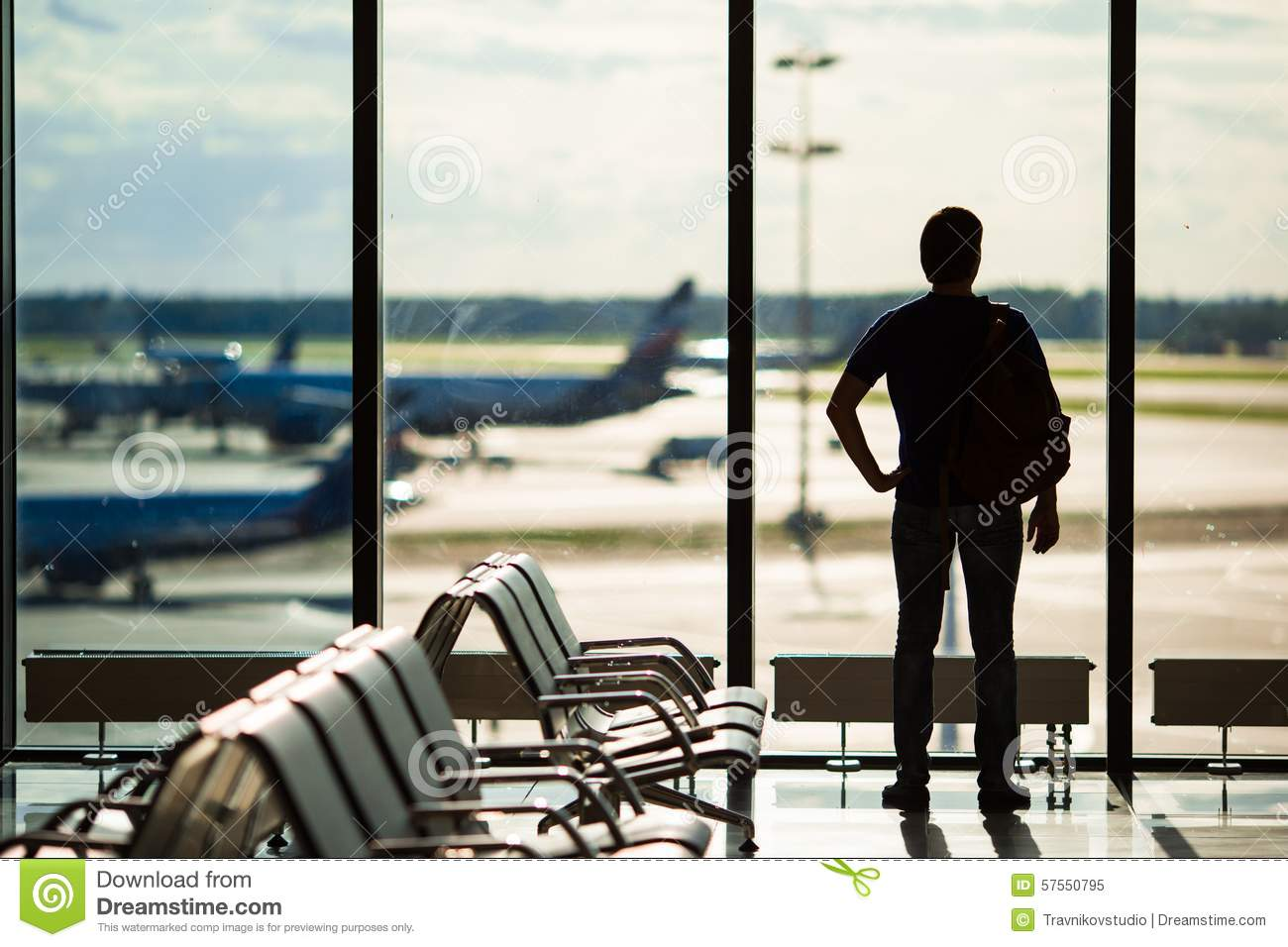 Silhouette of a man waiting to board a flight in