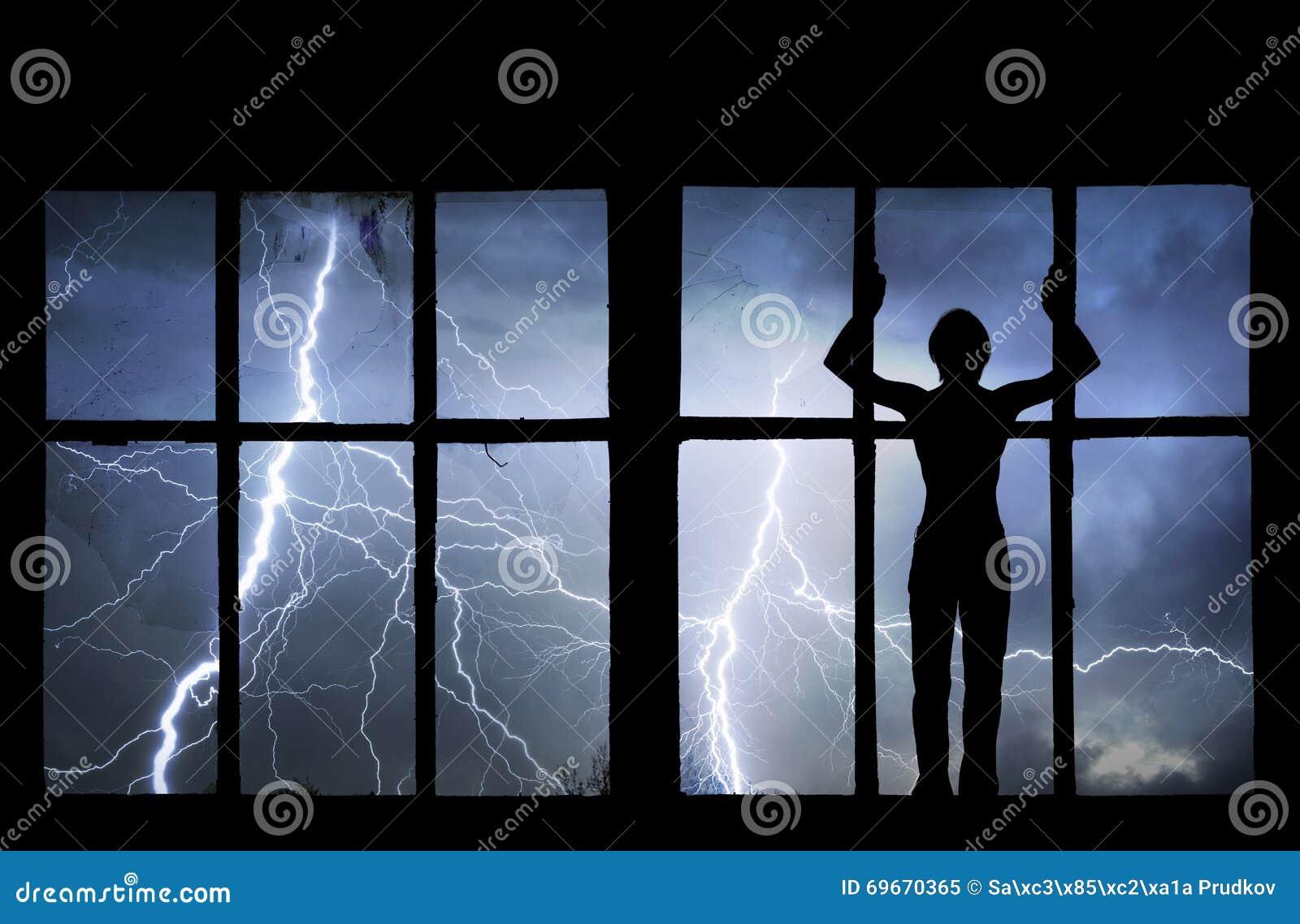 Silhouette of man watching lightning, thunder, rain and storm