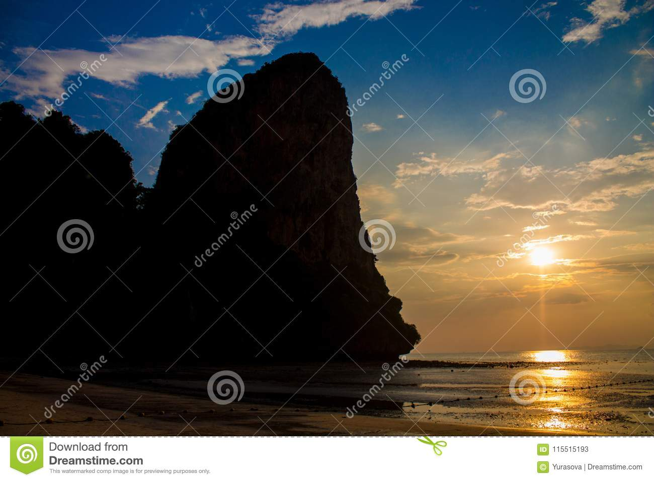 Silhouette of mountain cliff at sunset on sea beach resort in Thailand, Krabi, Railey and Tonsai