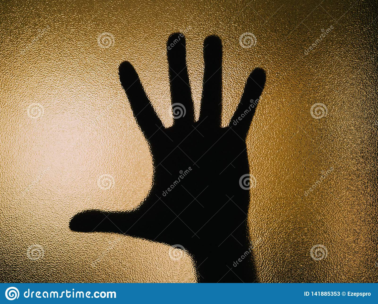 Silhouette of open hand on a glass