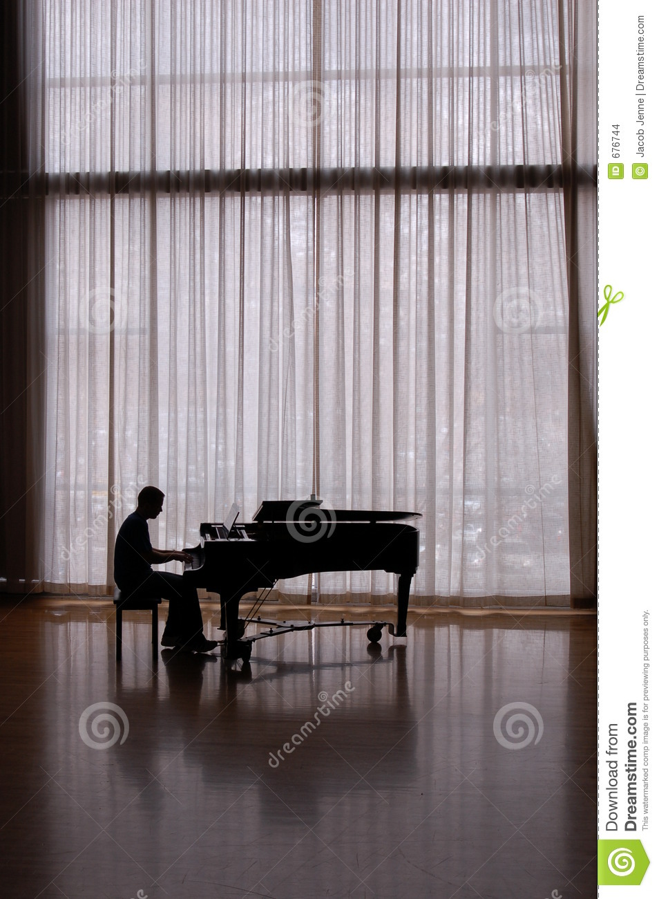 Silhouette pianist in a sunlit studio playing a baby grand piano Playing Piano Silhouette