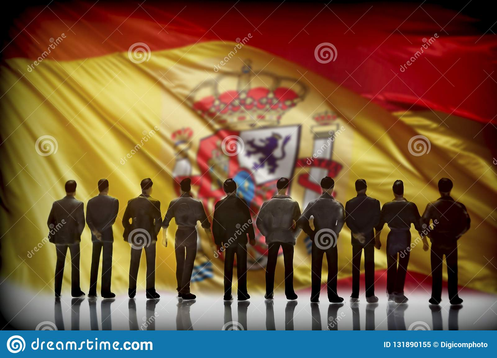 Silhouette of several men in front of the Spanish flag, conceptu. Al image royalty free stock photo