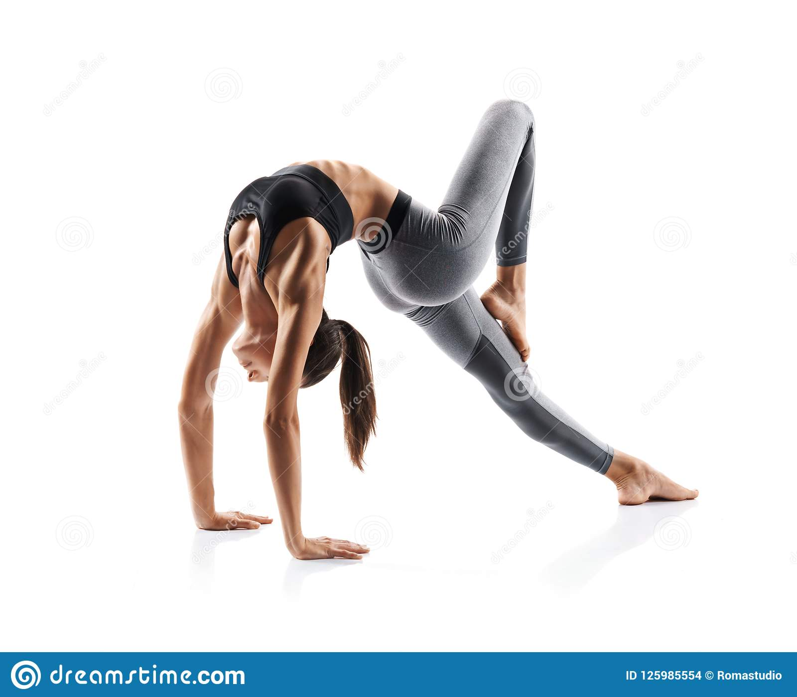 Silhouette of slim girl practicing yoga isolated on white background.
