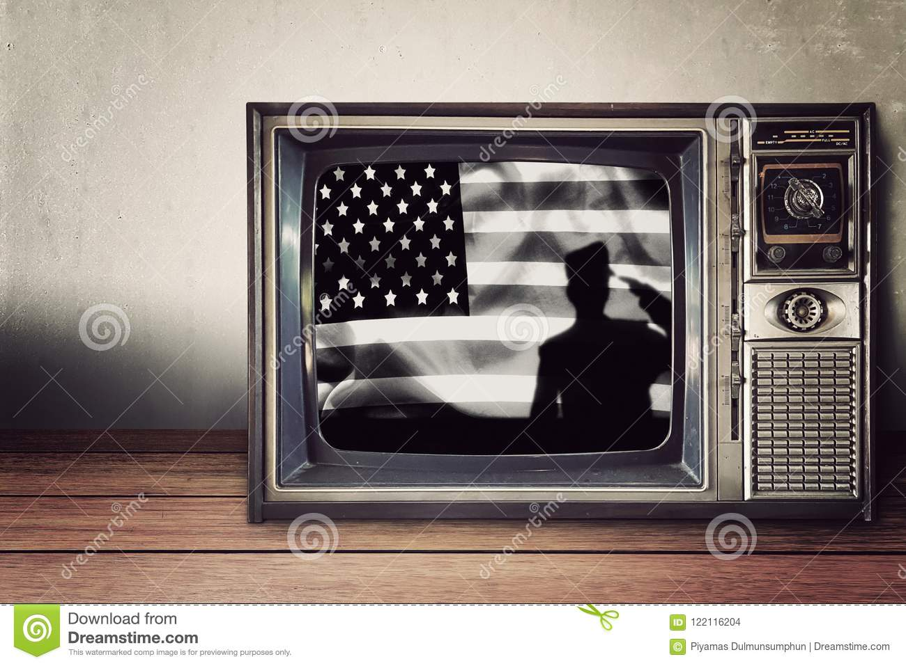 Silhouette of soldier on american flag in vintage television