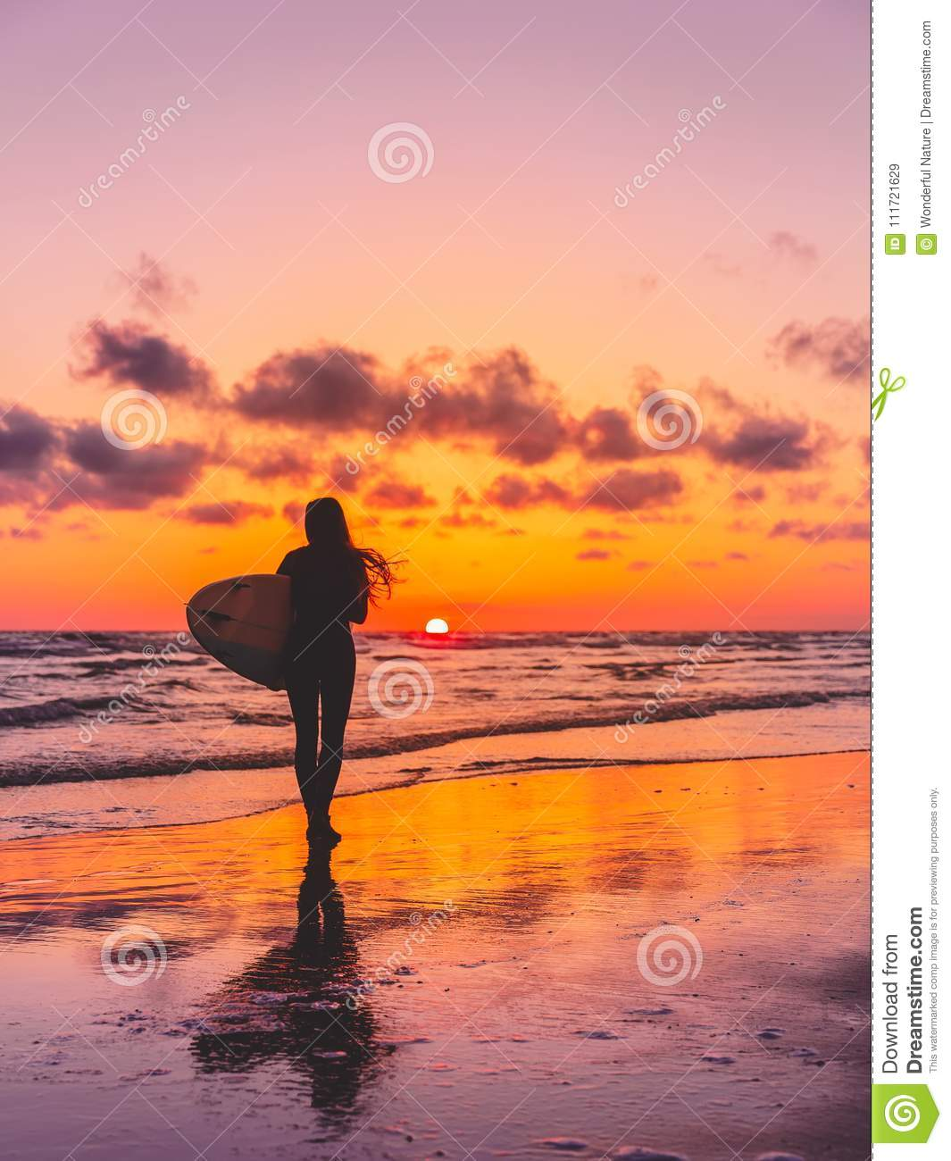 Silhouette Of The Surfer Girl With Surfboard On A Beach At ...