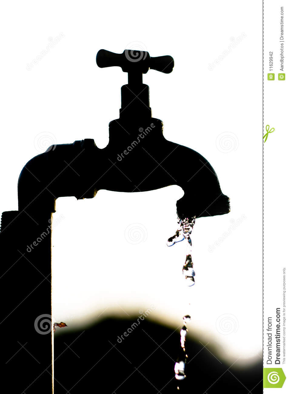 Silhouette Of A Tap Dripping Water Stock Photography