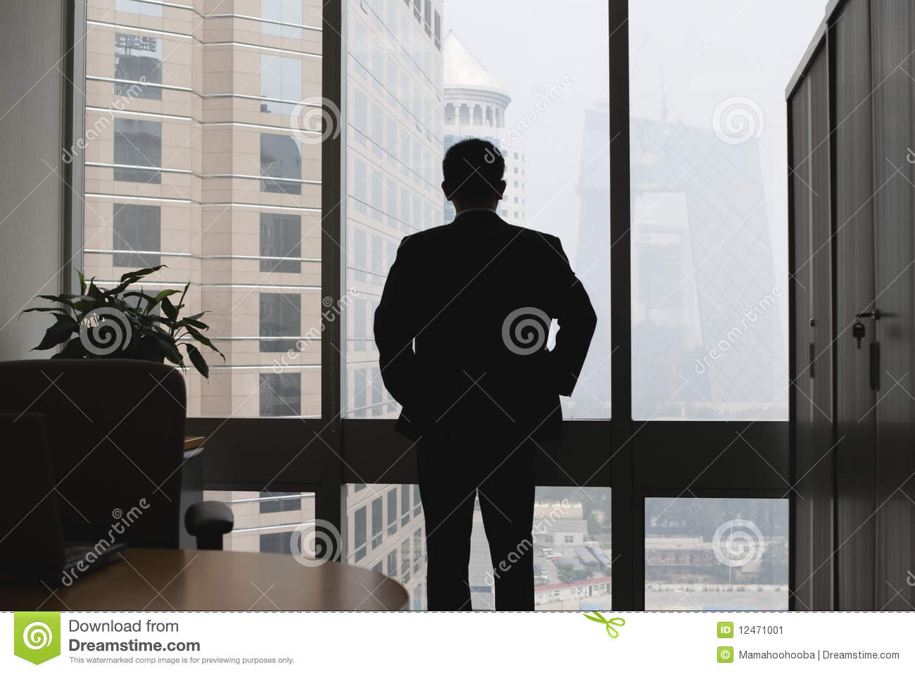 Silhouette of thinking businessman