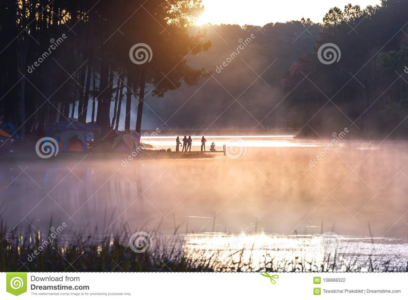 Silhouette of tourist enjoying at Pang Ung in morning, Mae Hong Son in Thailand
