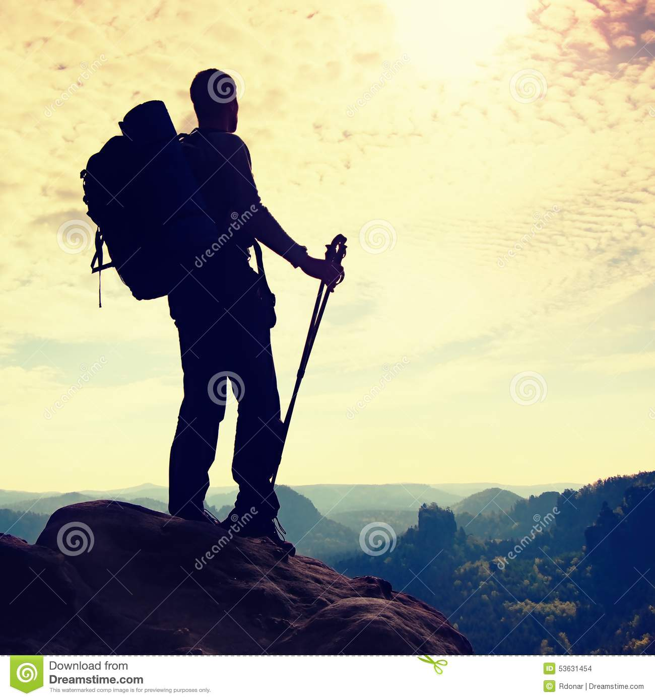 Silhouette Of Tourist With Poles In Hand  Hiker With Big Backpack