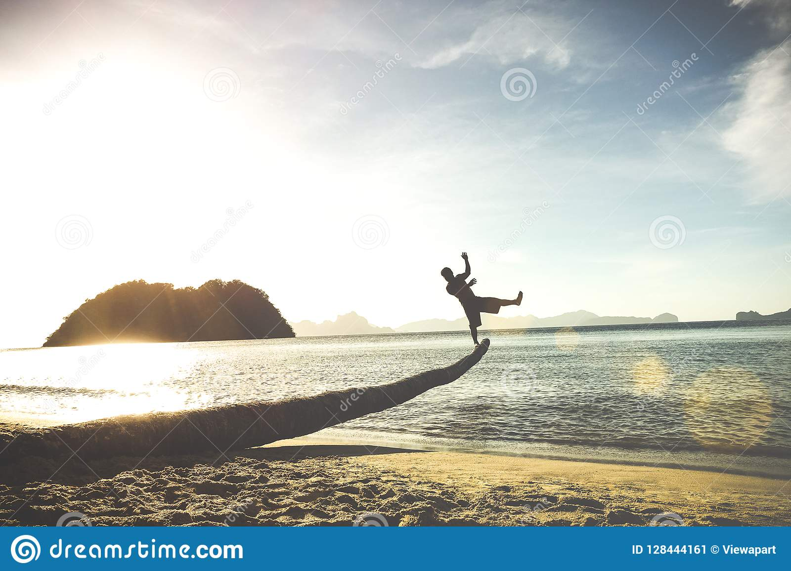 Silhouette Of Traveler Guy On Funny Jump From Palm Travel