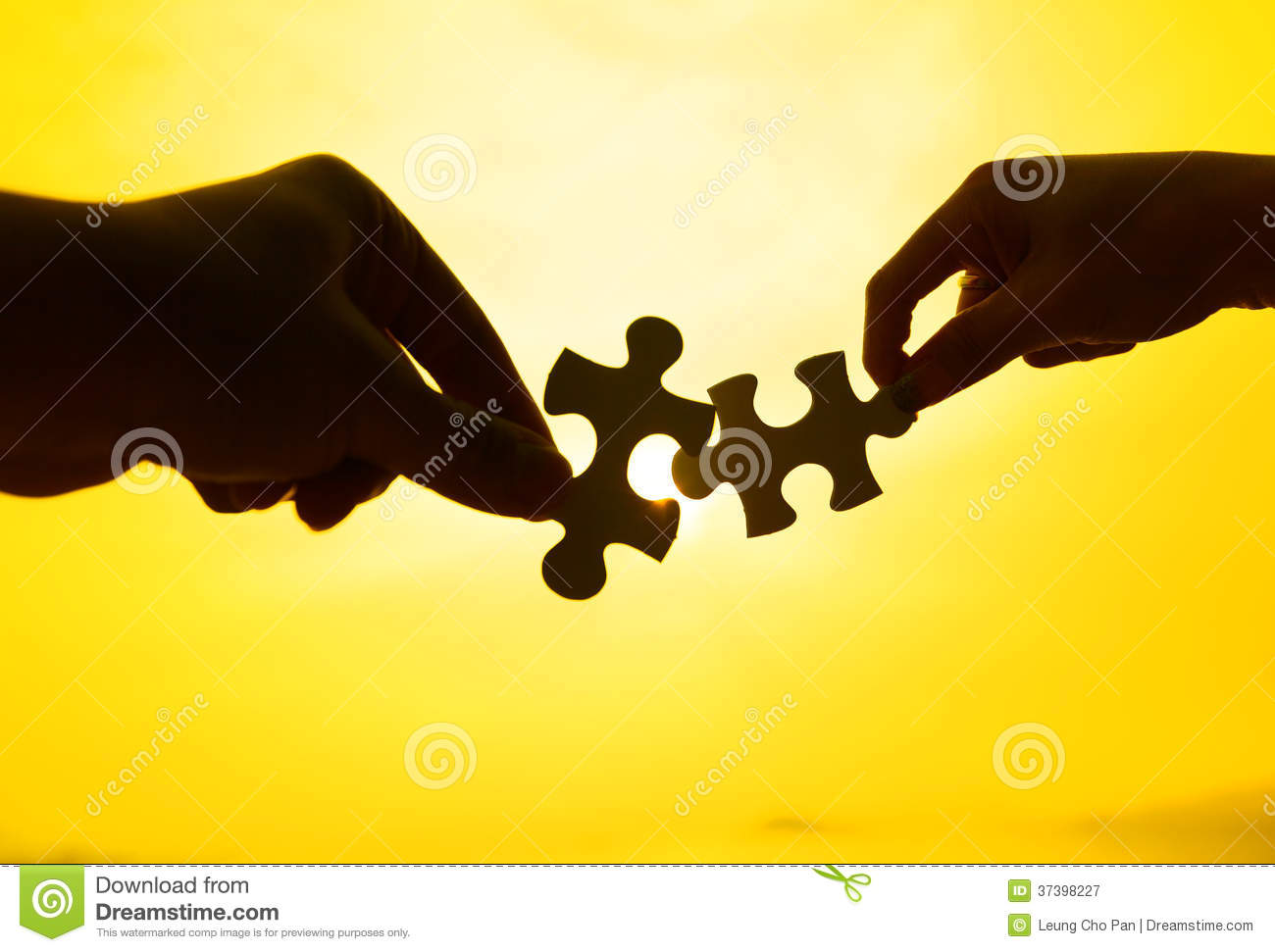 silhouette of two hands connect puzzle together stock image