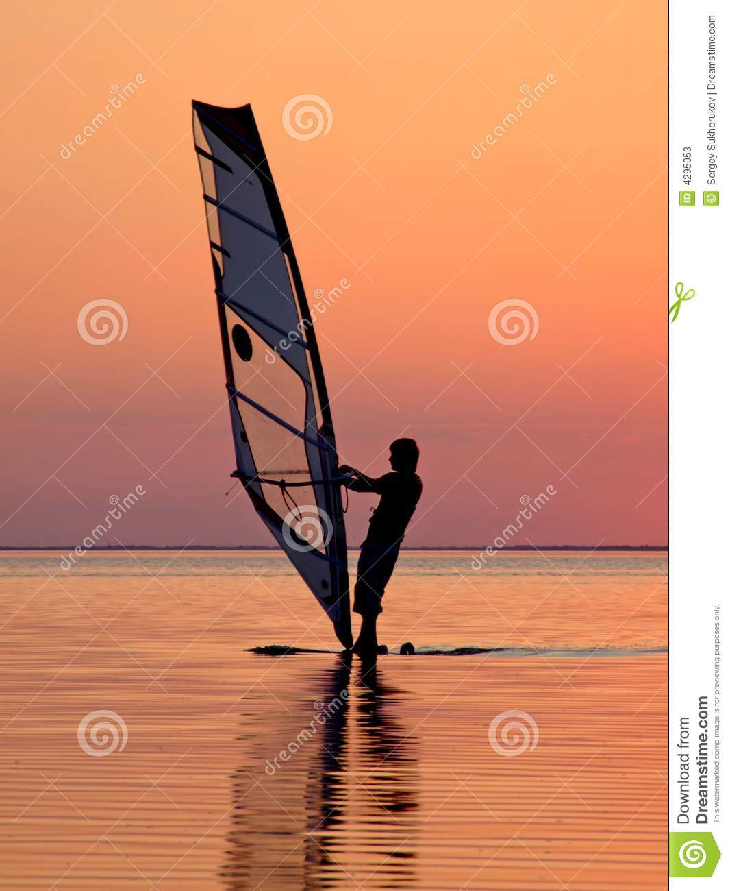 Silhouette of a wind-surfer on a sunset 3